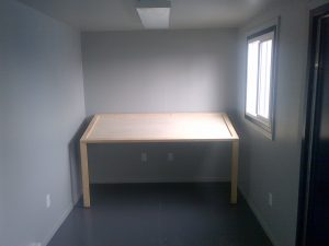Storage container with desk