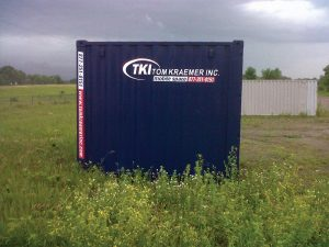 TKI Portable Storage Container In A Field All Alone